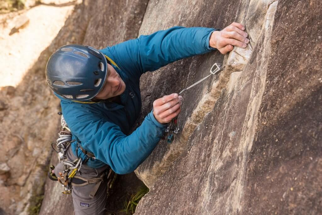 Trad climber placing gear